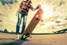 Young lady with skateboard on the road